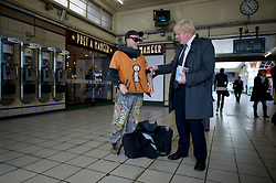 London Mayor Boris Johnson meets a graffiti artist in a tube station while out campaigning in West London, Thursday April 12, 2012. Photo By Andrew Parsons/i-Images