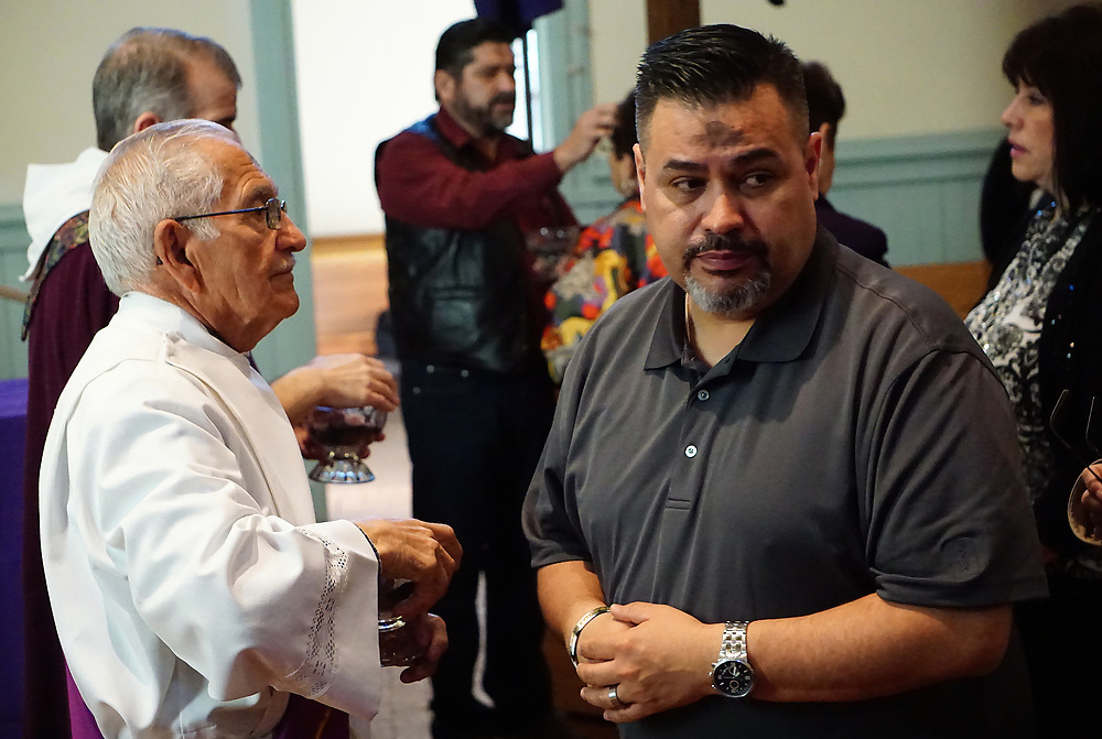 apl030117a/ASECTION/030117/pierre-louis/JOURNAL <br /> San Felipe de Neri Catholic Church Deacon Jose Lucero,, left administers ashes to parishioner Patrick Aguilar,, during the 7:00AM Mass at the Old Town church. Ash Wednesday marks the beginning of Lent  .Photographed  on Wednesday March 1, 2017. .Adolphe Pierre-Louis/JOURNAL