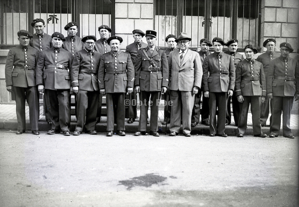 head of gendarme and a official in civic clothing with senior soldier group France 1940s