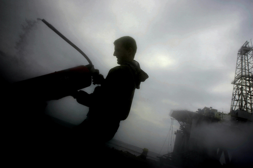 Brad Berg, 17, empties fire extinguishers while cleaning up storm damage on his father's dock in Sabine Pass  Friday September 19, 2008.  RRB Dock Services, LLC, was the only dock to remain fully operational immediately after Hurricane Ike.