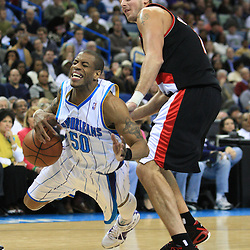 02 February 2009: New Orleans Hornets guard Antonio Daniels (50) trips while attempting to drive past Portland Trailblazers center Joel Przybilla (10) during a 97-89 loss by the New Orleans Hornets to the Portland Trail Blazers at the New Orleans Arena in New Orleans, LA.
