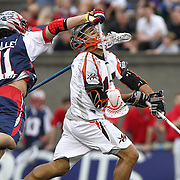Curtis Dickson #17 of the Denver Outlaws is hit by Matt Smalley #11 of the Boston Cannons during the game at Harvard Stadium on May 10, 2014 in Boston, Massachusetts. (Photo by Elan Kawesch)