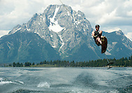 PRICE CHAMBERS / NEWS&amp;GUIDE<br /> Shayne Hansenjumps the wake of his powerboat on an Air Chair, also known as a Sky Ski, on Jackson Lake recently. The largest lake in Grand Teton National Park, Jackson Lake attracts speed freaks looking for a shot of adrenaline, families on pontoon boats exploring the huge reservoir's many coves and inlets, and swimmers and picnickers enjoying its cool waters and remote beaches.
