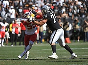 Sep 15, 2019; Oakland, CA, USA; Oakland Raiders tackle Kolton Miller(74) defends against Kansas City Chiefs defensive end Frank Clark (55) at Oakland-Alameda County Coliseum. The Chiefs defeated the Raiders 28-10..(Gerome Wright/Image of Sport)