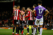 Brentford players celebrate a goal from Brentford Forward Neal Maupay (9) (score 2-0)  during the EFL Sky Bet Championship match between Brentford and Bolton Wanderers at Griffin Park, London, England on 13 January 2018. Photo by Andy Walter.