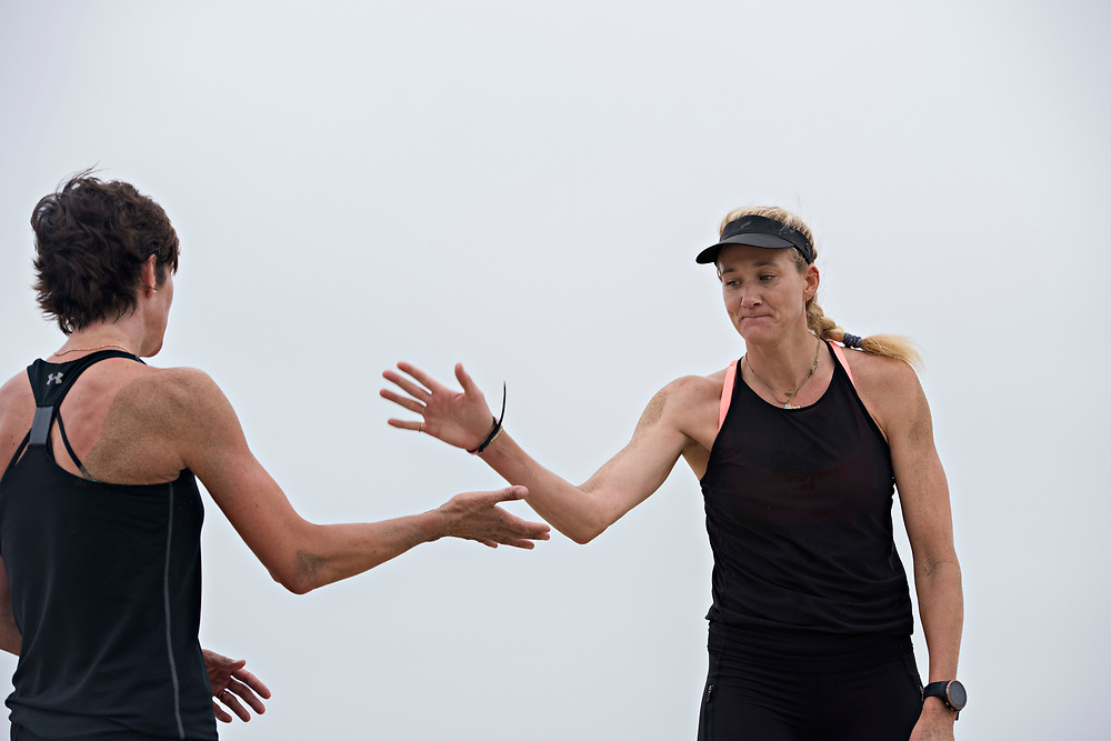 Kerri Walsh Jennings, right, high fives her new partner Nicole Branagh during an early morning practice on Manhattan Beach. The two 38-year-old professional beach volleyball players are hoping to play together through the World Tour Finals in late August, and have talked about making a run at the 2020 summer Olympics.