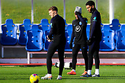England defender Joe Gomez and forward Raheem Sterling stand next to each other during the England football team training session at St George's Park National Football Centre, Burton-Upon-Trent, United Kingdom on 13 November 2019.