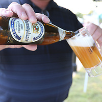 Libby Ezell | BUY at PHOTOS.DJOURNAL.COM<br /> Franz Asenbeck shows the proper way to pour a beer at Thursday's Octoberfest