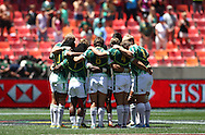 South Africa huddles for a Minutes Silence in remembrance of Former South African President Nelson Mandela who passed away on Thursday during the match between South Africa and Canada of the HSBC Sevens World Series Port Elizabeth Leg held at the Nelson Mandela Bay Stadium on 7th December 2013 in Port Elizabeth, South Africa. Photo by Shaun Roy