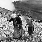 Pilgrims make the arduous climb up to the top of Croagh Patrick, Westport, Co. Mayo. A place of pilgrimage since St Patrick's time, and some say before that, on 'Reek Sunday', the last Sunday in July, thousands make the treacherous ascent..29.07.1962