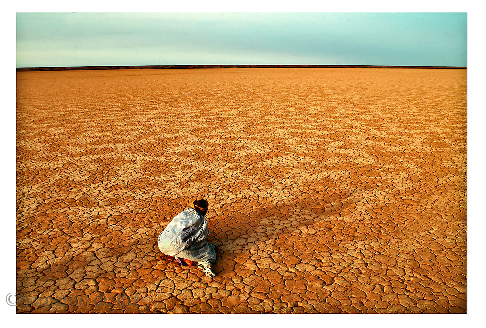 A Sahrawi nomad woman pray in The Sahrawi Arab Democratic Republic liberated territories.