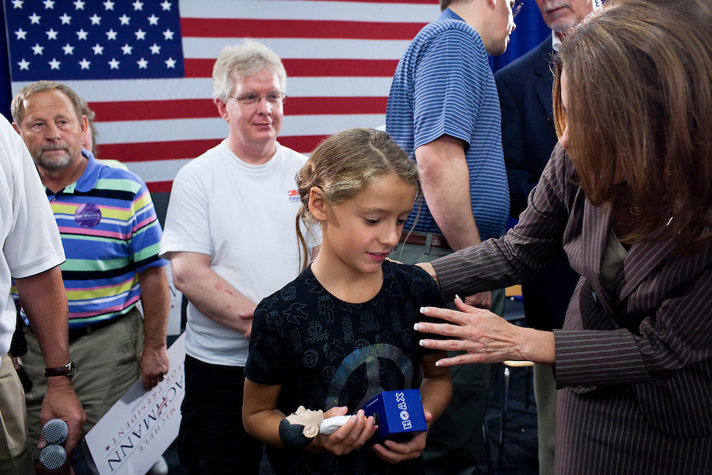 Republican presidential hopeful Michele Bachmann, right, poses for pictures at a campaign stop on Saturday, July 23, 2011 in Marshalltown, IA.
