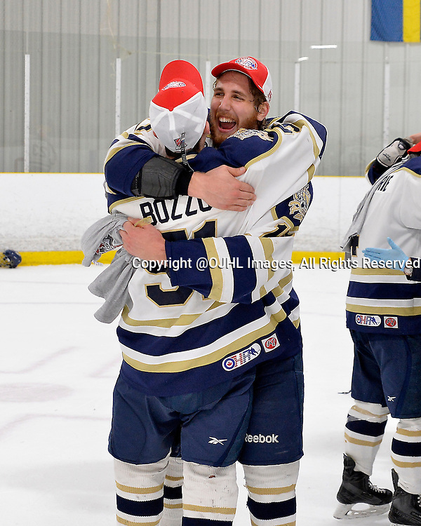 TORONTO, ON - Apr 22, 2015 : Ontario Junior Hockey League game action between the Toronto Patriots and the Kingston Voyageurs.  Game seven of the Buckland Cup Championship Series. Nicholas Geiser #17 of the Toronto Patriots celebrates with teammate Marco Bozzo #51.<br /> (Photo by Shawn Muir / OJHL Images)