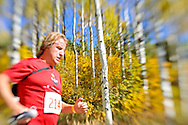 Philippe Werey runs past a grove of Aspens along the Government Trail on Buttermilk in the Golden Leaf half marathon.