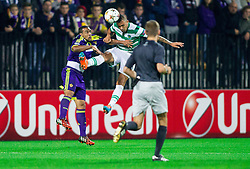 Marcos Tavares of Maribor vs Maurício of Sporting during football match between NK Maribor and Sporting Lisbon (POR) in Group G of Group Stage of UEFA Champions League 2014/15, on September 17, 2014 in Stadium Ljudski vrt, Maribor, Slovenia. Photo by Vid Ponikvar  / Sportida.com