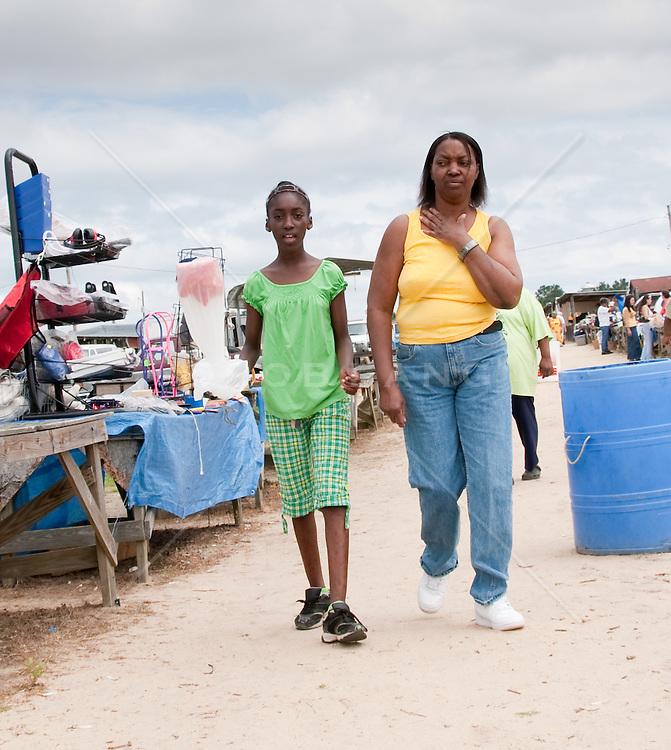 Girl and woman walking at a flea market in South Carolina