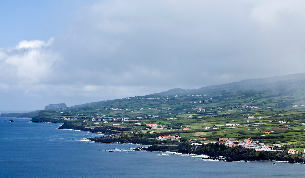 The view across the southern coast of Faial from Porto Pim in Horta. Horta is on the island of Faial. One of of the Azores, which is  a group of islands in the Atlantic that are a part of Portugal and the European Union. Horta is a popular stop for yachts crossing the Atlantic in the Spring time to return to Europe.