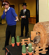 Boonshoft president and CEO Mark Meister looks on as MC Chris Mulcahy of WKEF-TV announce that Rosie has come out of her weather hutch and nibbled first on a treat on the Denver stump, predicting both that there would be an early Spring (since she didn't see her shadow,) and that the Denver Broncos would win the Super Bowl in front of a crowd in the education center at the Boonshoft Musum of Discovery in Dayton, Sunday, February 2, 2014.  This is the first time that Rosie, the Discovery Zoo's resident groundhog and part time weather predictor, has predicted the outcome of a major football game.