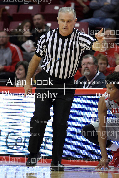 16 November 2014:  Referee Randy McCall calls over and back at half court during an NCAA non-conference game between the Utah State Aggies and the Illinois State Redbirds.  The Aggies win the competition 60-55 at Redbird Arena in Normal Illinois.