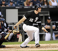 CHICAGO - AUGUST 09:  Conor Gillaspie #12 of the Chicago White Sox bats against the Minnesota Twins on August 9, 2013 at U.S. Cellular Field in Chicago, Illinois.  The Twins defeated the White Sox during the second game of a day-night doubleheader 3-2.  (Photo by Ron Vesely)   Subject:  Conor Gillaspie