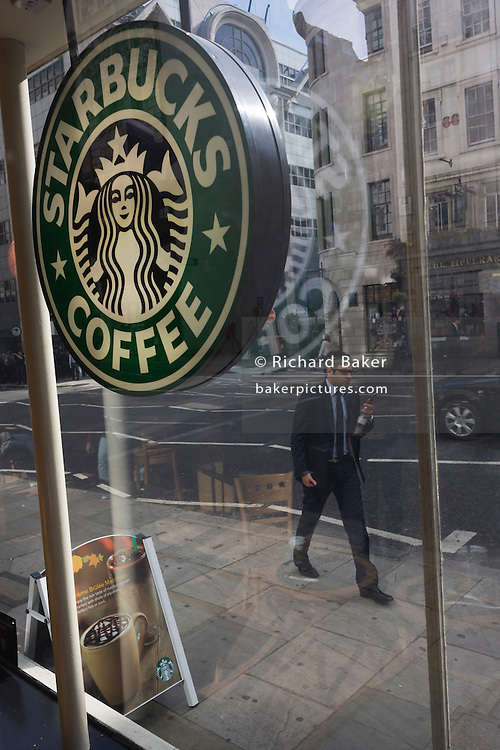 A branch of the American coffee chain, Starbucks in Fleet Street, central London.