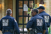 Officers from the Dallas Sheriff's Department stand outside the door of the apartment where a second Ebola patient has been reported in Dallas, Texas on October 13, 2014. (Cooper Neill for The New York Times)