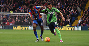 Ryan Bertrand looks to break past Wilfred Zaha during the Barclays Premier League match between Crystal Palace and Southampton at Selhurst Park, London, England on 12 December 2015. Photo by Michael Hulf.