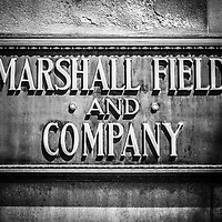 Chicago Marshall Field and Company sign in black and white. Marshall Field's was a popular Chicago department store and was acquired by Macy's in 2005.