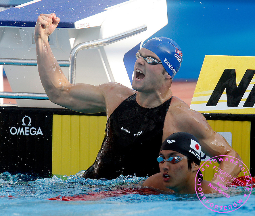 ROME 02/08/2009.13th Fina World Championships.Men's 50m Backstroke.Liam Tancock of Britain celebrates his new world record in the men's 50m backstroke swimming final near Japan's Junya Koga at the World Championships.photo: Piotr Hawalej / WROFOTO