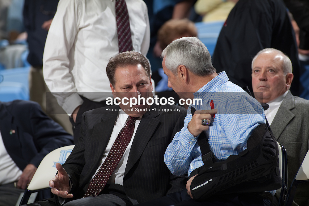 01 December 2009: North Carolina Tar Heels head coach Roy Williams (right) talks with Michigan State Spartans head coach Tom Izzo before an 82-89 North Carolina win over Michigan State at the Dean Smith Center in Chapel Hill, NC.