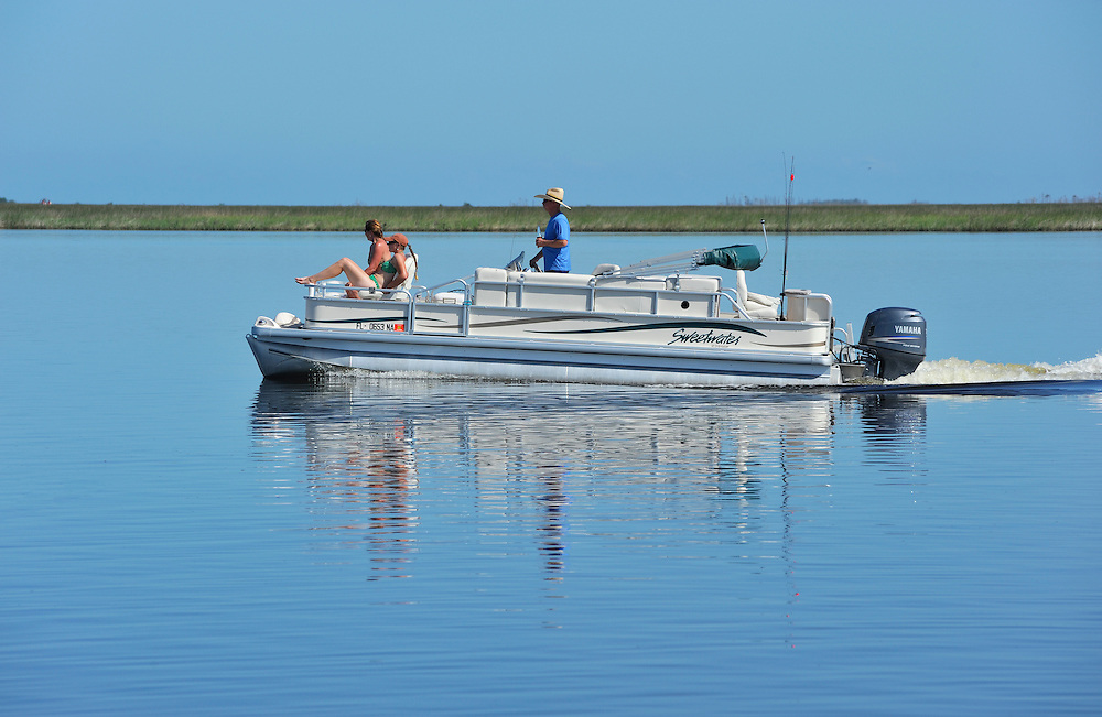 Boat on waterway at Chassahowitzka National Wildlife River Refuge, near Spring Hill, Florida, USA