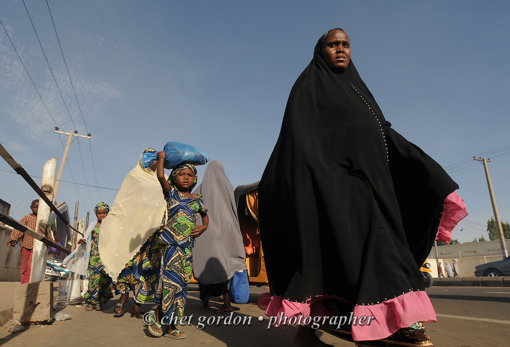 Pedestrians walk along a busy street in Kano, Nigeria on Wednesday afternoon, December 5, 2012.