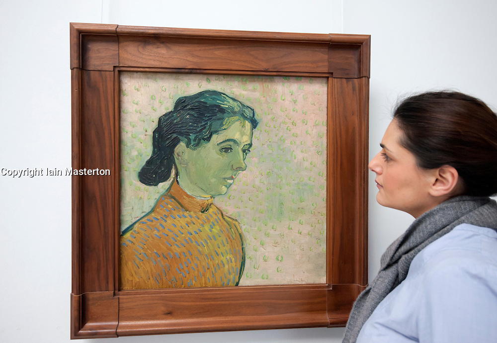 Woman looking at painting Portrait of a Young Lady by Vincent van Gogh at Kroller-Muller Museum in The Netherlands