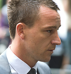 © London News Pictures. 13/07/2012. London, UK. England Footballer and Chelsea FC Captain JOHN TERRY arriving at Westminster Magistrates court on July 13, 2012, where a verdict  of not guilty was returned  today in John Terry's trial for allegedly using a racist obscenity about Queens Park Rangers player Anton Ferdinand. Photo credit: Ben Cawthra/LNP.