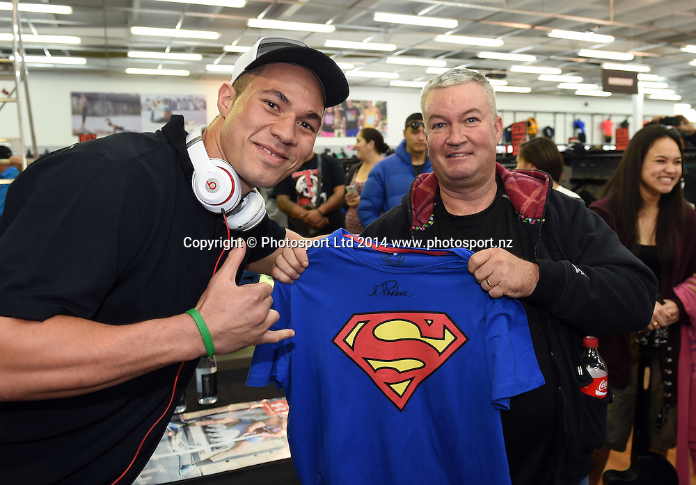 Boxer Joseph Parker with Craig Rush from Papakura during a signing session at Rebel Sport Manukau for sponsor Under Armour ahead of the Parker v Minto Hydr8 Zero Heavyweight Explosion fight scheduled for 5 July 2014. Auckland. Saturday 28 June 2014. Photo: Andrew Cornaga/www.photosport.co.nz