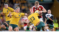22 June 2013; Tom Croft, British & Irish Lions, is tackled by Michael Hooper, left, and Kurtley Beale, Australia. British & Irish Lions Tour 2013, 1st Test, Australia v British & Irish Lions, Suncorp Stadium, Brisbane, Queensland, Australia. Picture credit: Stephen McCarthy / SPORTSFILE