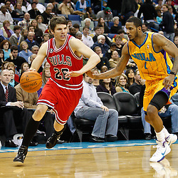 February 12, 2011; New Orleans, LA, USA; Chicago Bulls shooting guard Kyle Korver (26) drives past New Orleans Hornets small forward Trevor Ariza (1)  during the fourth quarter at the New Orleans Arena. The Bulls defeated the Hornets 97-88.  Mandatory Credit: Derick E. Hingle