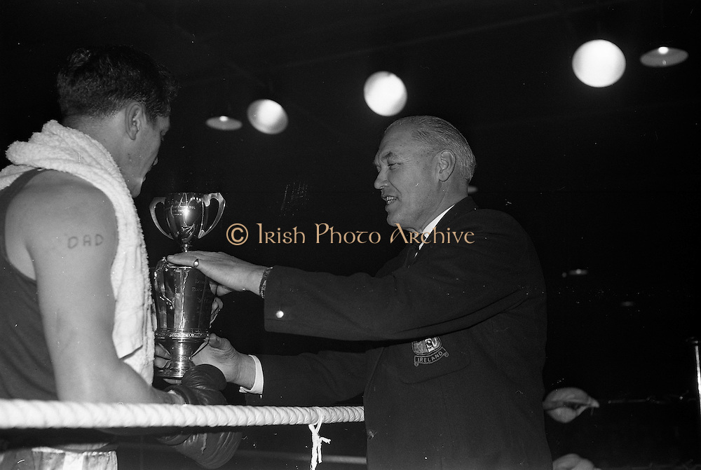25/01/1963<br /> 01/25/1963<br /> 25 January 1963<br /> National Junior Boxing Championships at the National Stadium, Dublin. Picture shows Deputy Commissioner P. Carroll, President of the I.A.B.A., presenting B. Chadwick of St. Eugene's Boxing Club, Derry, the National Junior Heavyweight Champion of Ireland 1963 with his trophy and replica, after he beat J.B. Coker of Dublin University.
