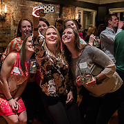 WASHINGTON,DC - MAR20: Sweet Briar College alumni take a selfie at a pop-up fundraiser at Mission in Dupont Circle, to save the womens' college in Virginia, which will close if it can't raise $250 million dollars, March 20, 2015. (Photo by Evelyn Hockstein/For The Washington Post)