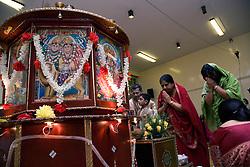 People worship at the celebration of Navratri; the Hindu festival of Nine Nights,