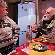 """Alexander Demidov, 61, sits with his friend, writer Stanislav Konstatinov 65, Chernobyl explosion in 1986. They were part of  a massive team of """"liquidators"""" responsible for the clean up of the nuclear fallout in the months and years that followed. <br /> <br /> They have been living in Slavutych for the last decades. Demidov is suffering from multiple health problems in his lungs and joints, while Konstantinov is healthy. <br /> <br /> Slavutych rises out of the ashes of the Chernobyl nuclear disaster in April 26, 1986. People living near the disaster area were largely moved to the new city, built from scratch for the sole purpose of housing the population displaced by the nuclear accident."""