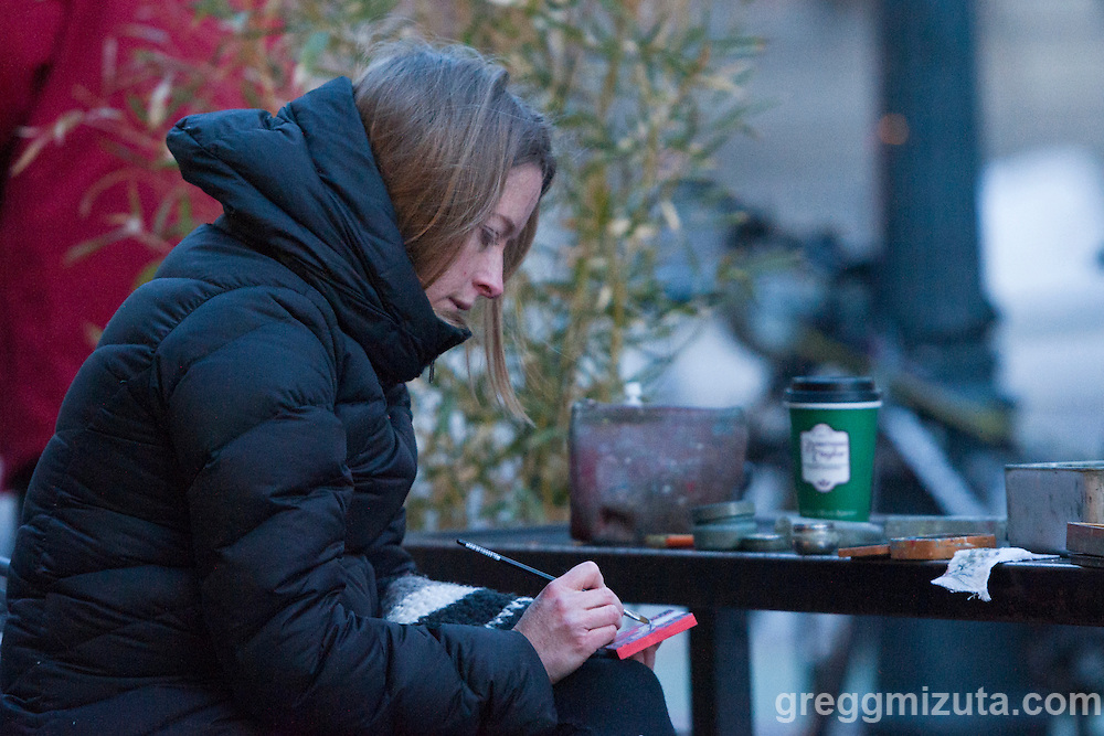"Boise artist Rachel Teannalach paints her  365th tinyExpanse painting of her ""Year of Daily Paintings"". The temperature was a chilly 15°F as she completed her final painting of the year outside of Dawson Taylor Coffee Roasters in downtown Boise, 8th and Bannock, December 1, 2015."