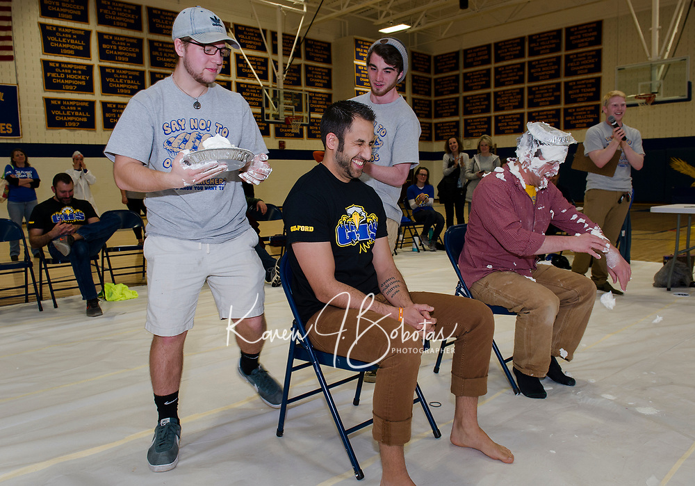 """Leaman Antone braces for what's coming after watching Jason Javalgi get """"pied"""" by Tyler Pearson at Gilford High School during the """"Pie a Teacher"""" to benefit The Doorway at LRGH on Friday afternoon.  (Karen Bobotas/for the Laconia Daily Sun)"""