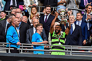 Forest Green Rovers Dan Wishart(17) lifts the play off final trophy during the Vanarama National League Play Off Final match between Tranmere Rovers and Forest Green Rovers at Wembley Stadium, London, England on 14 May 2017. Photo by Adam Rivers.
