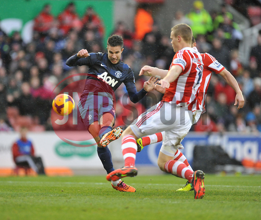 Manchester United's Robin van Persie shoots inside the box and scores his teams only goal of the game. - Photo mandatory by-line: Alex James/JMP - Tel: Mobile: 07966 386802 01/02/2014 - SPORT - FOOTBALL - Britannia Stadium - Stoke-On-Trent - Stoke v Manchester United - Barclays Premier League