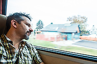 Traveler (Tim McGuire) riding a train between Seattle, Washington, USA and Vancouver, BC , Canada.