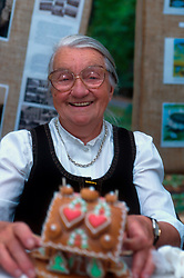 CZECH REPUBLIC PRAGUE JUL00 - Jirina Dvorakova (68) decorates plates of gingerbread which fit together as a gingerbread house. Mrs Dvorakova is a representative of folkloristic craftsmen who promotes her small trade.. . jre/Photo by Jiri Rezac. . © Jiri Rezac 2000. . Tel:   +44 (0) 7050 110 417. Email: jiri@jirirezac.com. Web:   www.jirirezac.com