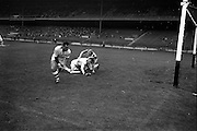 11/09/1966<br /> 09/11/1966<br /> 11 September 1966<br /> National Hurling League Final: New York v Kilkenny at Croke Park, Dublin.<br /> Early in the game, M. Morrissey (New York left back) and T. Walsh (Kilkenny forward) find themselves on the ground while New York goalie, K. Croke, whips the ball away to safety.