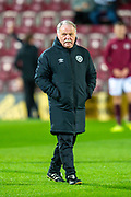 Heart of Midlothian coach Donald Park watches the players warm up before the Ladbrokes Scottish Premiership match between Heart of Midlothian FC and Livingston FC at Tynecastle Park, Edinburgh, Scotland on 4 December 2019.