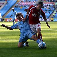 Photo: Mark Stephenson.<br /> Coventry City v Bristol City. Coca Cola Champel chaionship. 15/09/2007.Coventry's Arjan De Zeeuw gets the better off Michael McIndoe